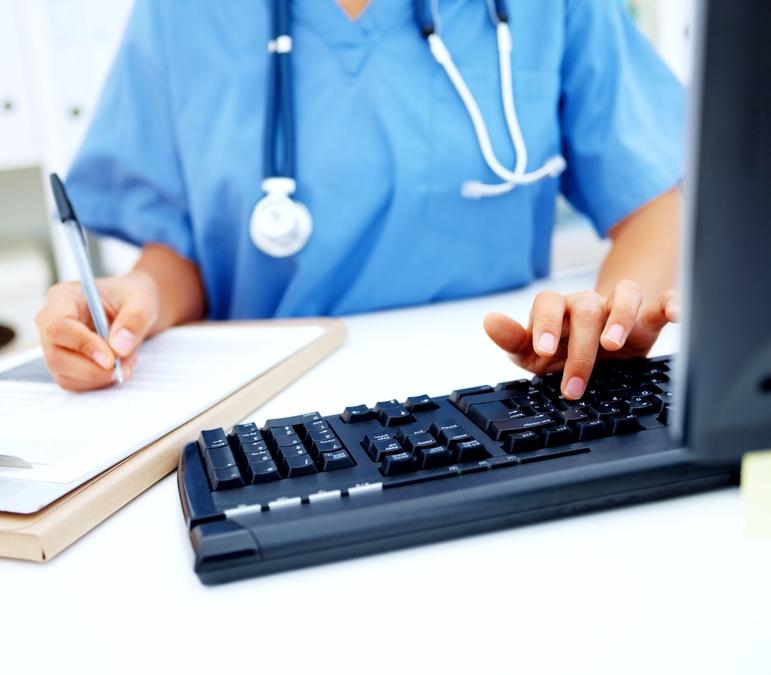 Medical - Nurse typing at her desk